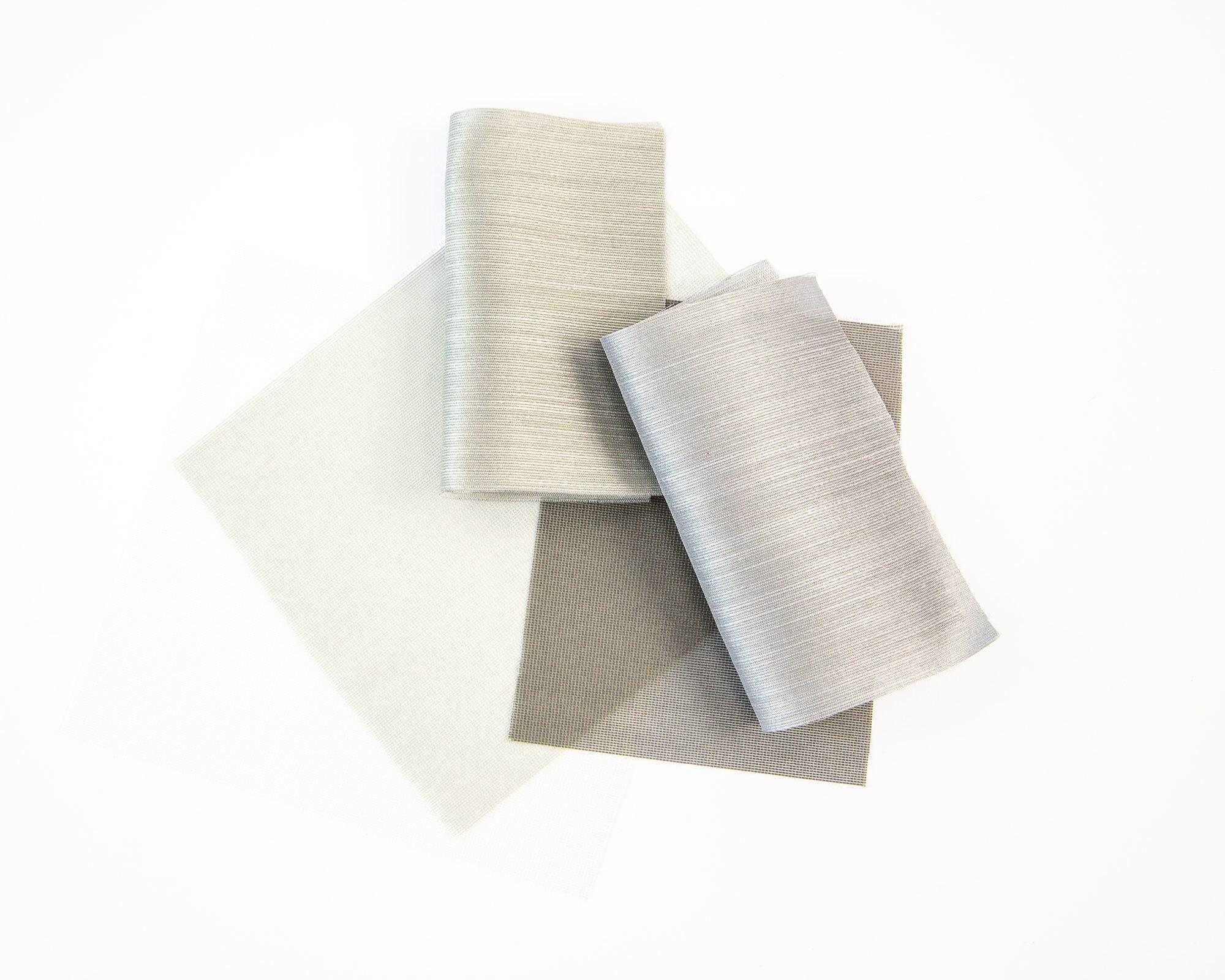 Vorhangstoffe Face und Cloud mit Blend- und Wärmeschutz aus der Glare & Heat-Kollektion von Création Baumann.